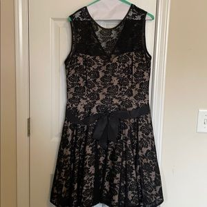 Beautiful black dress with tan under layer!